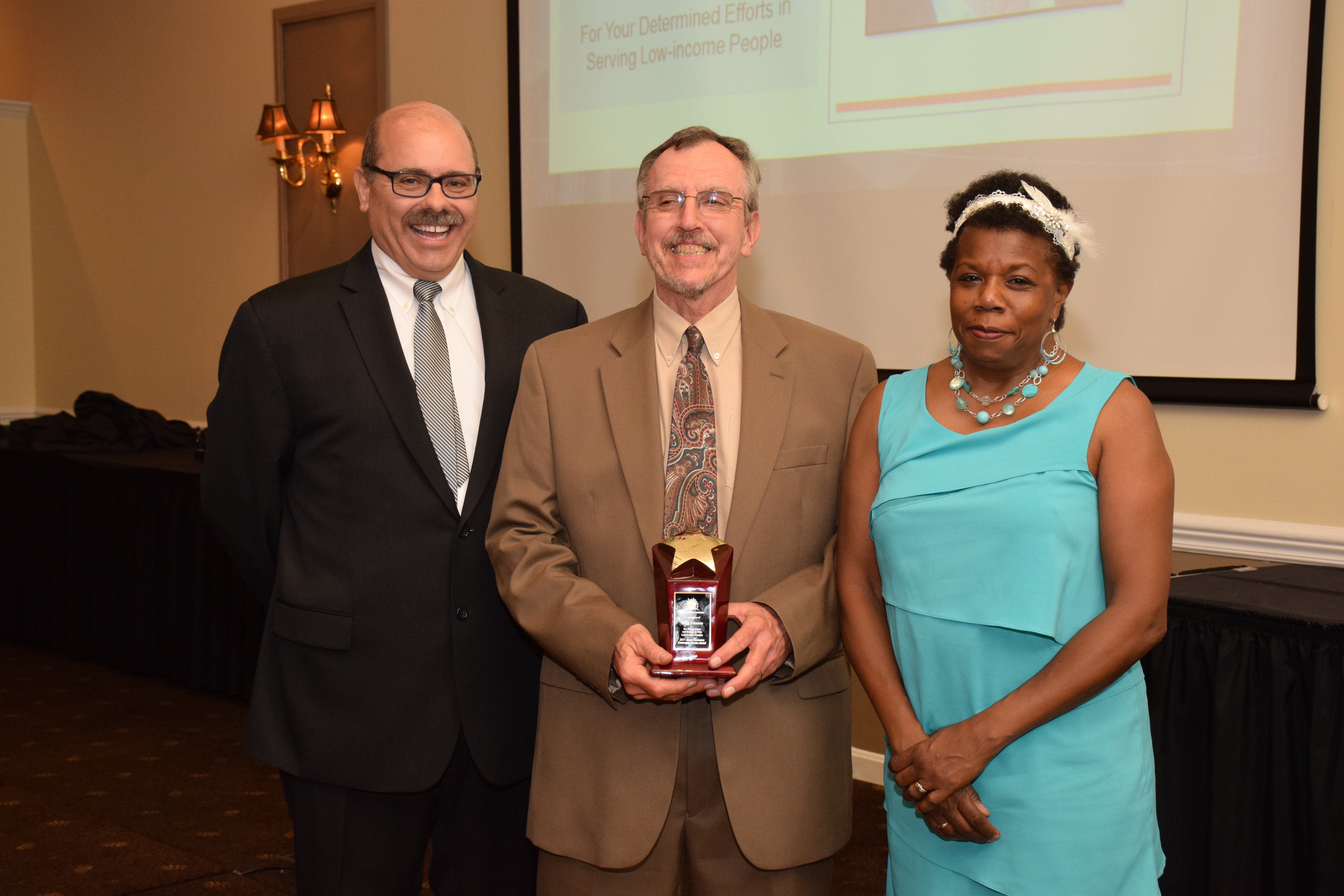Left: Jeffrey Diver, SELF's Executive Director; Middle: Mike Johnson, 2017 Janet Clemmons Award Winner; Right: Lori Elliott, SELF's Board President , at SELF's Roaring '20s Annual Awards Dinner.